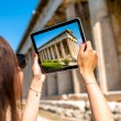 Woman photographing Hephaistos temple in Agora — Stock Photo #72993805