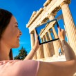 Woman photographing Parthenon temple in Acropolis — Stock Photo #73045675