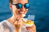 Woman eating greek yogurt — Stock Photo