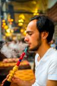 Man smoking turkish hookah — Stock Photo