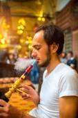 Man smoking turkish hookah — Stock Photo