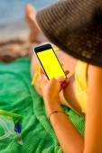 Woman using mobile phone on the beach — Stock Photo