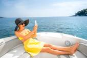 Woman relaxing with digital tablet on the yacht — Stock Photo