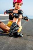 Sport woman with rollers on the highway — Stockfoto