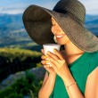 Woman with coffee cup in the mountains — Stock Photo #76687203