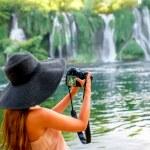 Woman tourist near Kravica waterfall — Photo #76718951