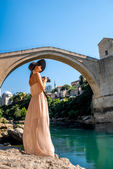 Woman photographing city view in Mostar — Stock Photo