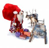 Santa Claus with big bag of gifts and his reindeer sleigh — Stock Photo