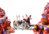 Santa Claus with his reindeer and gifts — Stock Photo