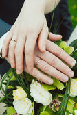 Hands with wedding rings — Stock Photo