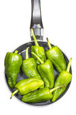 Isolated pan with green peppers — Stock Photo