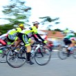 Motion blur of a group of cyclists in action during a cycling tour — Stock Photo #65494697