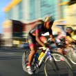 Motion blur of a group of cyclists in action during a cycling tour — Stock Photo #65495001
