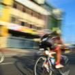 Motion blur of a group of cyclists in action during a cycling tour — Stock Photo #65497293
