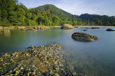 Slow shutter against rocks and blue sky in Pangkor Island, Malaysia — Stok fotoğraf