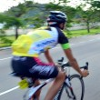 Motion blur of a group of cyclists in action during a cycling tour — Stock Photo #65608457