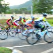 Motion blur of a group of cyclists in action during a cycling tour — Stock Photo #65608699