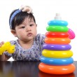 Asian cute baby girl playing with colorful pyramid toy isolated on white background — Stock Photo #66111911