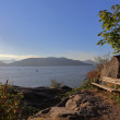 The bench on cliff in rays of the evening sun with view on the bay — Stock Photo #52927721