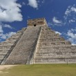 Mayan people architecture. Temple of Kukulkan in Chichen Itza on the background of blue sky — Stock Photo #58318803