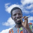 African man holding a miswak (traditional teeth cleaning twig) — Stock Photo #51932737
