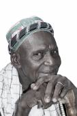 Old African man wearing traditional clothing, isolated — Stock Photo