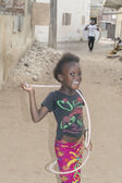 Editorial caption, Thiaroye, Senegal, Africa, July 28, 2014, Unidentified girl playing with a jump rope in the street, popular district of Guinaw Rails — Stock Photo