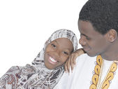 Young Afro couple showing love and affection, isolated — Stock Photo