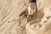 Man holding some sand in the hand — Stock Photo