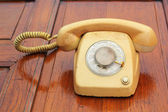 Old phone vintage style on the wooden floor. — Stock Photo
