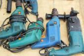 Power drill and titanium coated drill bit — Stock Photo