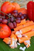 Crab sticks with fruits and vegetables — Stock Photo