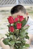 Red rose at beautiful in hand — Stock Photo