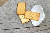 Tasty of crackers on wood table — Stock Photo