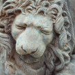 Lion sculptures spraying water on wall background — Stock Photo #67855205