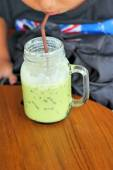 Iced green tea and milk is delicious — Stock Photo