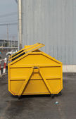 Trash can dustbins big yellow outside. — Stock Photo
