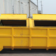 Trash can dustbins big yellow outside. — Stock Photo #73977227