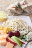 Pasta spaghetti with salad mix fruit and bread sandwich. — Stock Photo