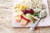 Pasta spaghetti with salad mix fruit. — Stok fotoğraf