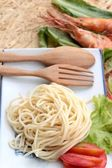 Pasta spaghetti with shrimp on the plate. — Stock Photo