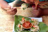 Pasta spaghetti with crab sticks and sauce. — Stock Photo