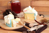 White cream cake delicious and drink red water mix soda — Stock Photo