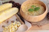 Corn soup of condensed in a wooden bowl — Stock Photo