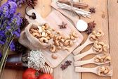 Roasted cashews nuts with natural on wood background — Stock Photo
