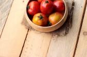Fresh tomato on wood background — Stock Photo
