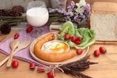 Breakfast with eggs, sausage, bread, salad vegetables and milk. — Stock Photo