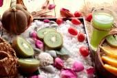 Oat flakes with fruit, kiwi, orange, tomato and kiwi juice. — Stock Photo