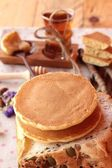 Sweet pancake with honey of delicious. — Stock Photo