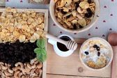 Corn flake with currant dried fruit ,cashew nuts and milk. — Stock Photo